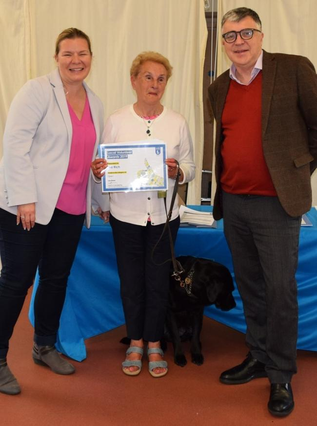 Eva Rich and guide dog Oyster are pictured with Guide Dogs' HR chief, Katie Wery, and head of Guide Dogs Cymru, Jonathan Mudd