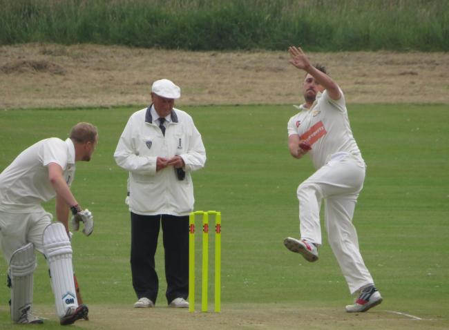 Jamie Lewis bowls for Lawrenny as they won through to the DR Morris Cup final. PICTURE: Western Telegraph.