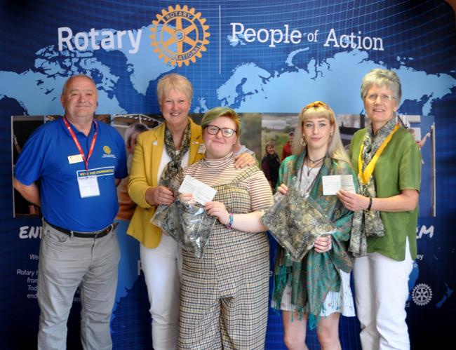 Mia Hewitson-Jones and Sam Stables are pictured with members of Narberth and Whitland Rotary.