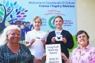 Wendy Kehoe and Yvonne Evans, clerks to Dale and Marloes & St Brides Community Councils, are pictured with the Coastlands pupils proudly displaying their winning route-marker designs.