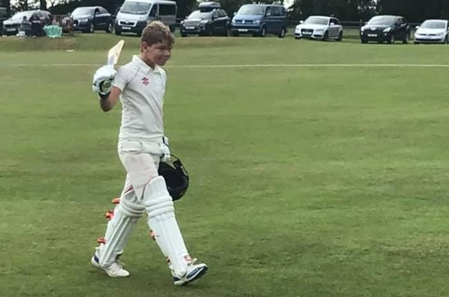 Charlie Arthur leaves the field after maiden century.