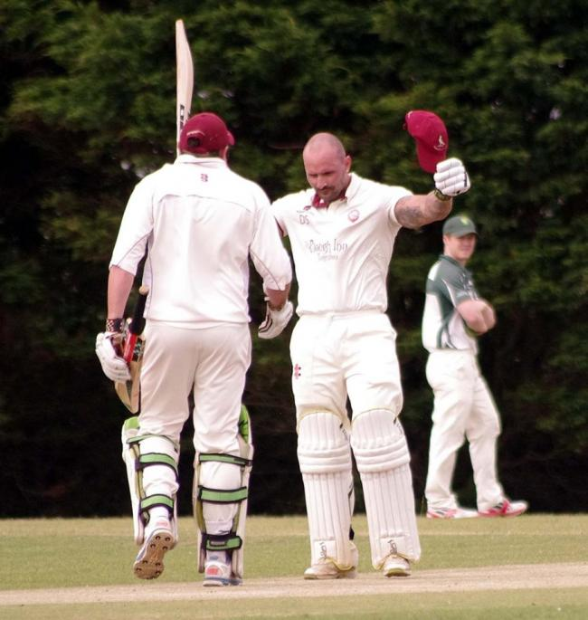Dan Sutton celebrates his ton. PICTURE: Western Telegraph.