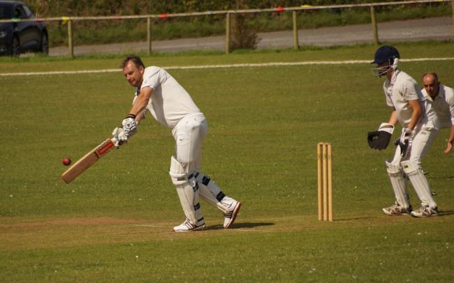 Karl canes the Burton bowling as Tish 2nds take the title