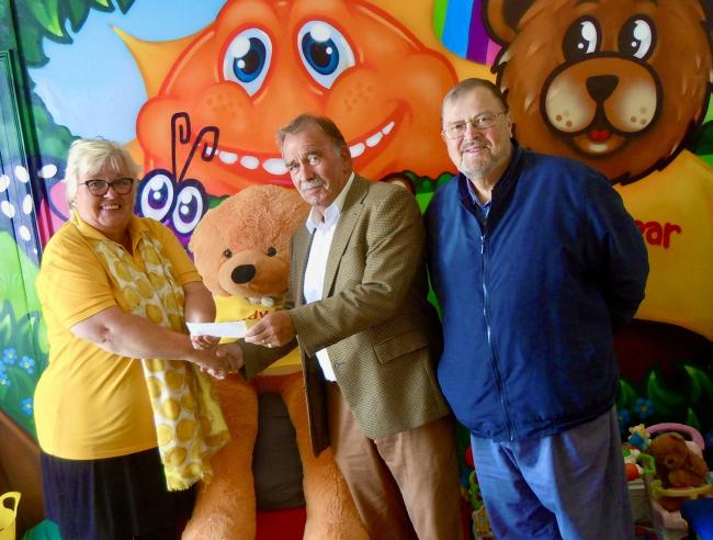 Anita Hicks from the Sandy Bear children's bereavement charity is pictured with Bryn Lewis and Colin Jenkins of Neyland Masonic Lodge.