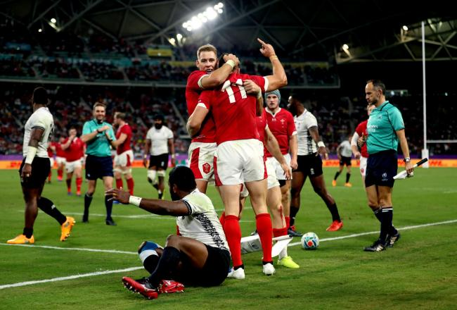 Josh Adams celebrates a try hat trick in the thrilling game between Wales and Fiji. PICTURE: PA Wire.