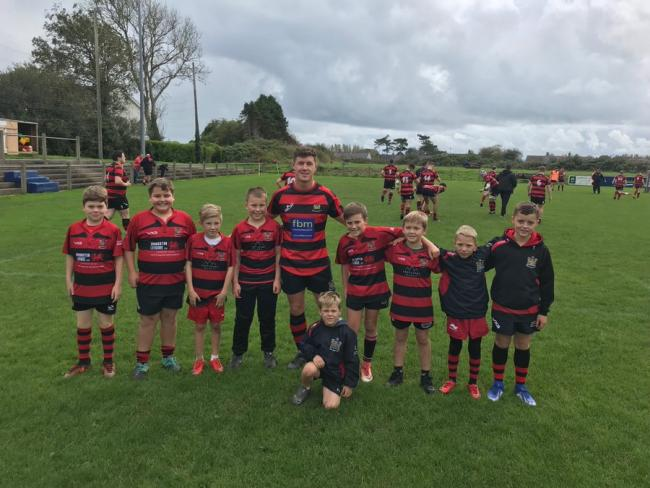 Lloyd Thomas captained Tenby for the first time and posed with club juniors after the game.