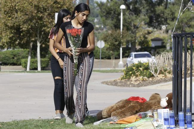Students leave flowers outside the school