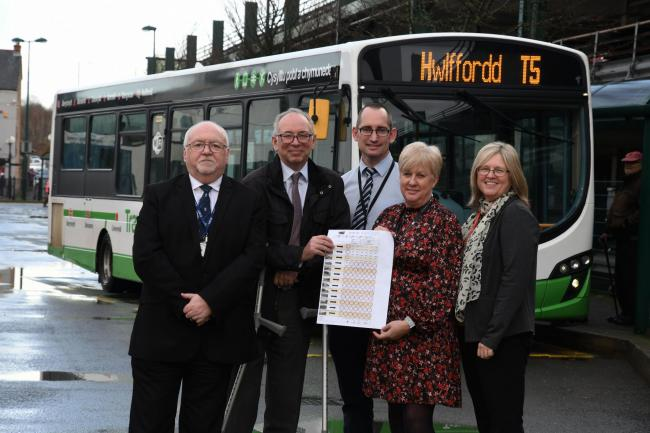 Councillor Baker is pictured (left) with the new timetable along with: Nigel Miller (Health Board Head of Therapies); Owen Roberts (Council Passenger Transport Co-ordinator); Mel Marshalsey (Health Board Learning Disabilities Service) and Peta Rogers (Cou