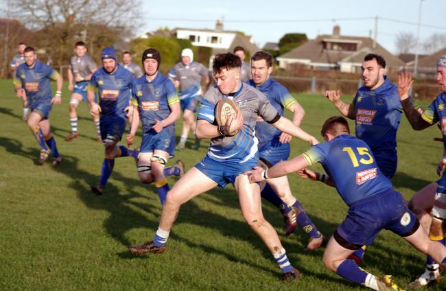 Jack Evans steps past an Aberaeron defender. PICTURE: Western Telegraph.