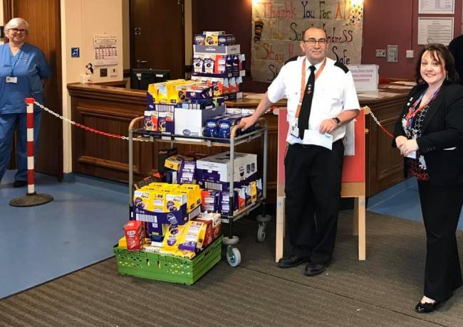 A Milford Haven School representative donates the eggs to Withybush