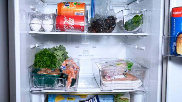 Milford Mercury: Use an organising set to create more storage zones in your fridge. Credit: Reviewed / Betsey Goldwasser