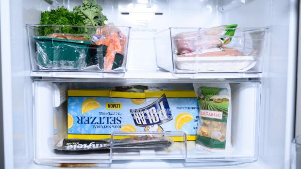 Milford Mercury: We lined the bottom of the fridge bins with kitchen towel—you can also use fridge mats. Credit: Reviewed / Betsey Goldwasser