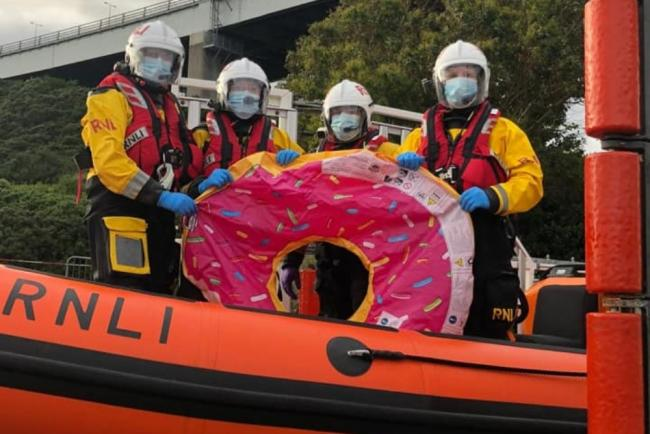 Lifeboat crew with inflatable