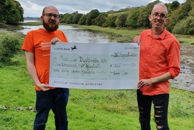 James Day (right) presents his £1,267 cheque for Muscular Dystrophy UK to Philip Roach, representing the charity