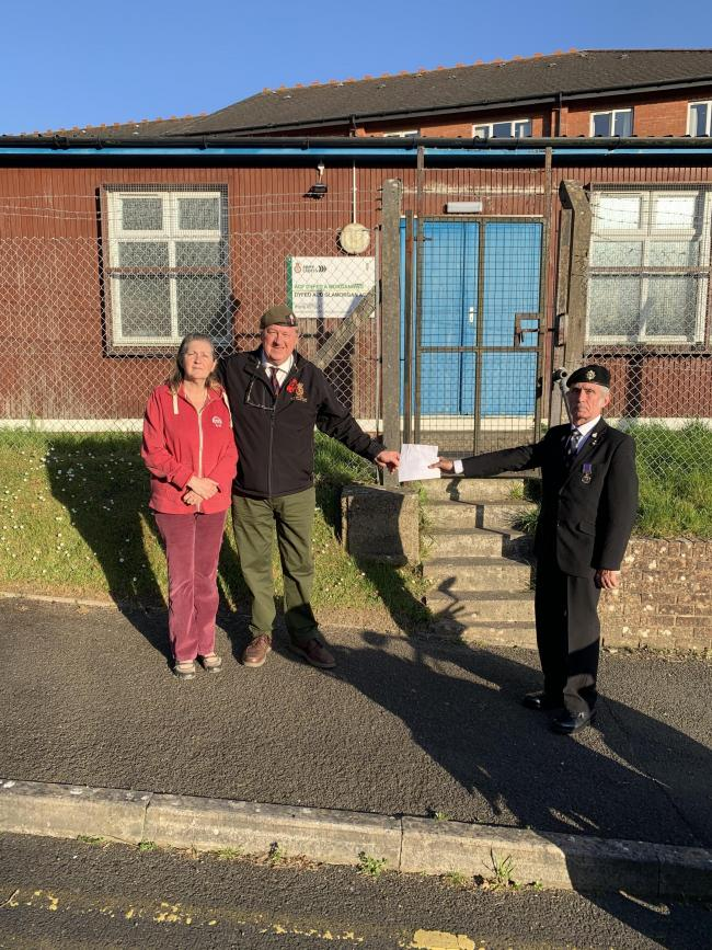 Mark and Jill Cable presenting the cheque to the Royal British Legion