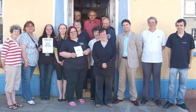PATCH TEAM: Pictured in the photograph are PATCH Co-ordinator Tracy Olin, and Stephen Crabb MP, along with a number of PATCH volunteers celebrate the opening og the charity's new branch at Hill Street, Haverfordwest.