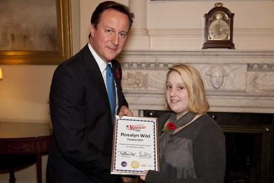 caption: Prime Minister David Cameron meets Britain's Kindest Kid finalist Rosalyn Wild.