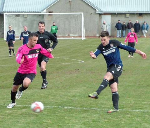 Hakin United's Ashley Bevan strikes a left foot shot against champions Merlins Bridge.