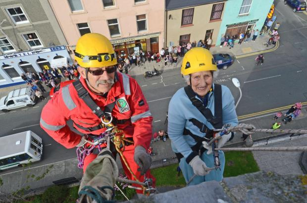 Milford Mercury: DAREDEVIL: 92-year-old Eileen Williams abseiled down St John's Church in Pembroke Dock on Tuesday (September 10) afternoon.  PICTURE: Martin Cavaney. (1093002)