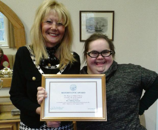 Milford Mercury: SPECIAL PRESENTATION: The Mayor, Cllr Southwell presents Bethany with a civic award PICTURE: Wester Telegraph (2844415)