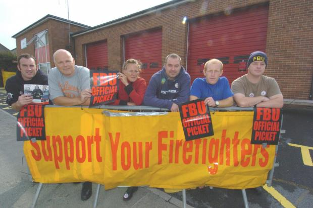 FEARS FOR THE FUTURE: FBU representative Graeme Callan (far right) and fellow Pembroke Dock firefighters went on strike in November over a pension dispute with the government.  PICTURE: Martin Cavaney. (2847289)