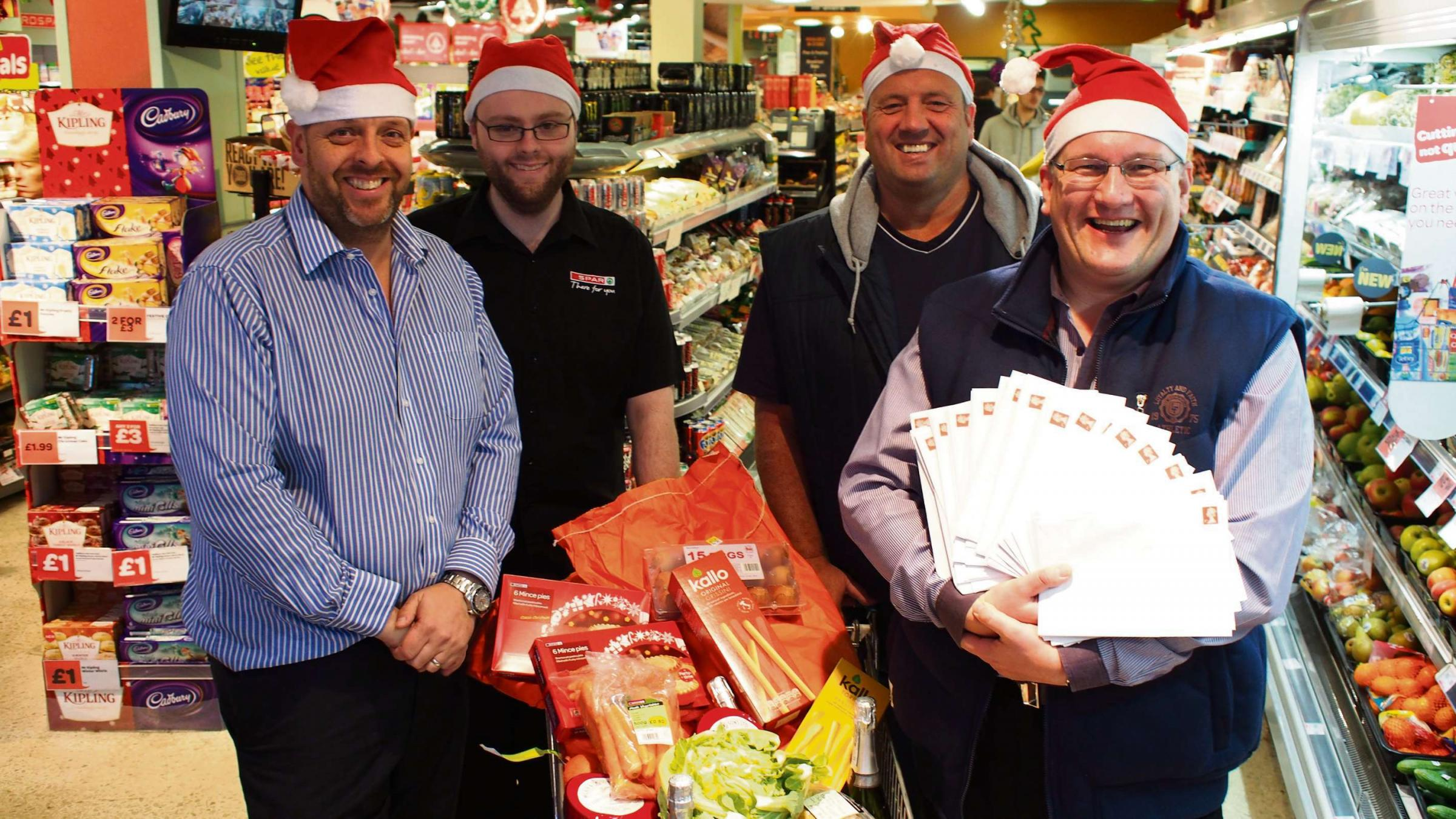 EARLY CHRISTMAS PRESENT: EuroSpar Milford Haven owner Chris Ward with store manager Richard Harries, Colin Sharp and Cllr Guy Woodham. PICTURE: Milford Haven (2949704)