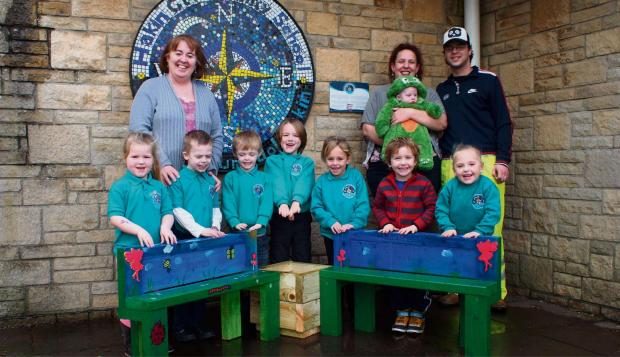 ALL FRIENDS: Children from Dolphins, Turtles and Penguins classes with Mrs Delyth Evans, and Byron Jenkins and Nikki Austin of Cariad Crafts. PICTURE: Western Telegraph (3101376)