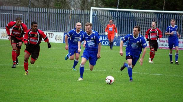 ON THE ATTACK: Haverfordwest County central midfielder Chris O'Sullivan charges forward against Caerau Ely. (3136796)