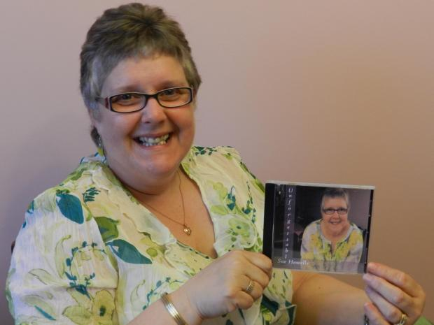 Milford Mercury: SONGS FOR DAD: Sue Howells with her CD.  PICTURE: Milford Mercury.