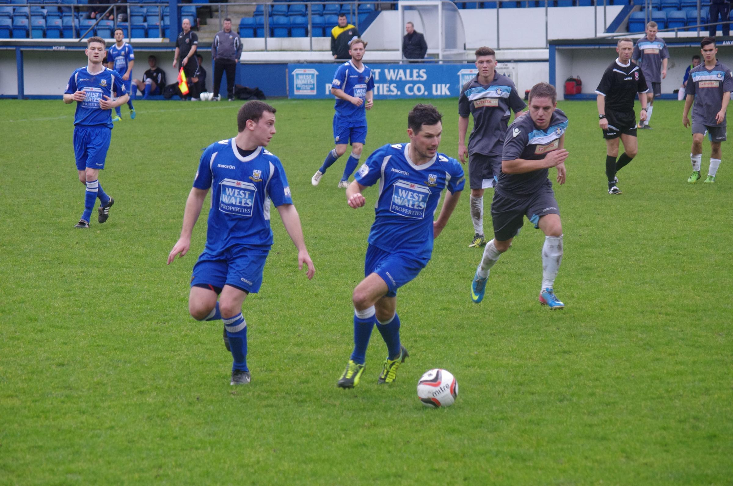 League leaders lose out at home