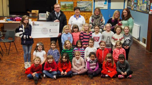 Milford Mercury: LOOK, LEARN, LAUGH: The new group is presented with a cheque for £150 from Milford Haven Round Table. PICTURE: Milford Mercury (3579654)