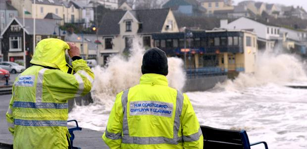 Coastguard team members keep the public away from the dangerous sea front at Saundersfoot. PICTURE: Gareth Davies Photography.