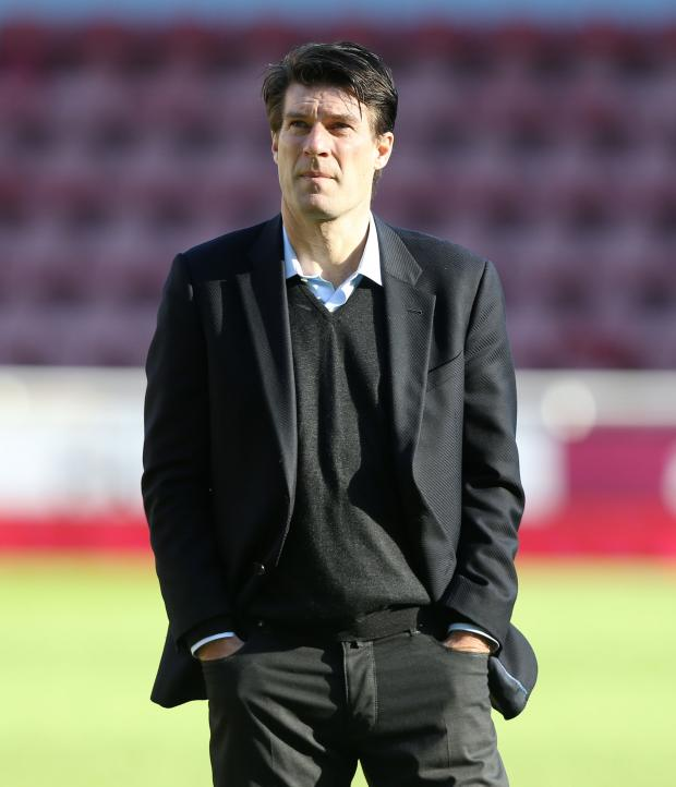 Milford Mercury: FINAL DAYS: Michael Laudrup at Upton Park following Swansea's abject defeat at West Ham. PICTURE: Huw Evans Photo Agency.