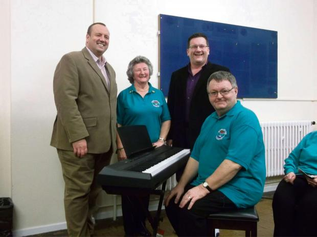 DONATION: Left to right.  Cllr Colin Sharp (Mayor's consort 2012/13).  Trish Campadonic. (Choir Chairlady).  Cllr Guy Woodham (Mayor 2012/13).  Peter Griffiths (Choir Accompanist). (3801061)