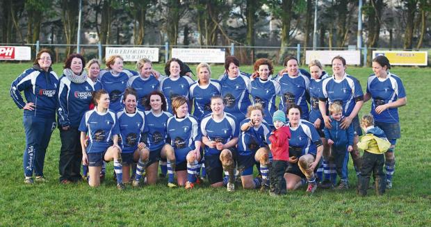 FEELING BLUE: Haverfordwest Ladies celebrate their cup success against Abergavenny. (4148875)