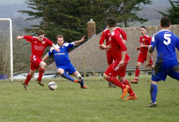 JUST BRILL: West Dragons' Joey Brill skips past Merlins Bridge player manager Lee Hudgell's tackle. PICTURE: Western Telegraph. (4350259)