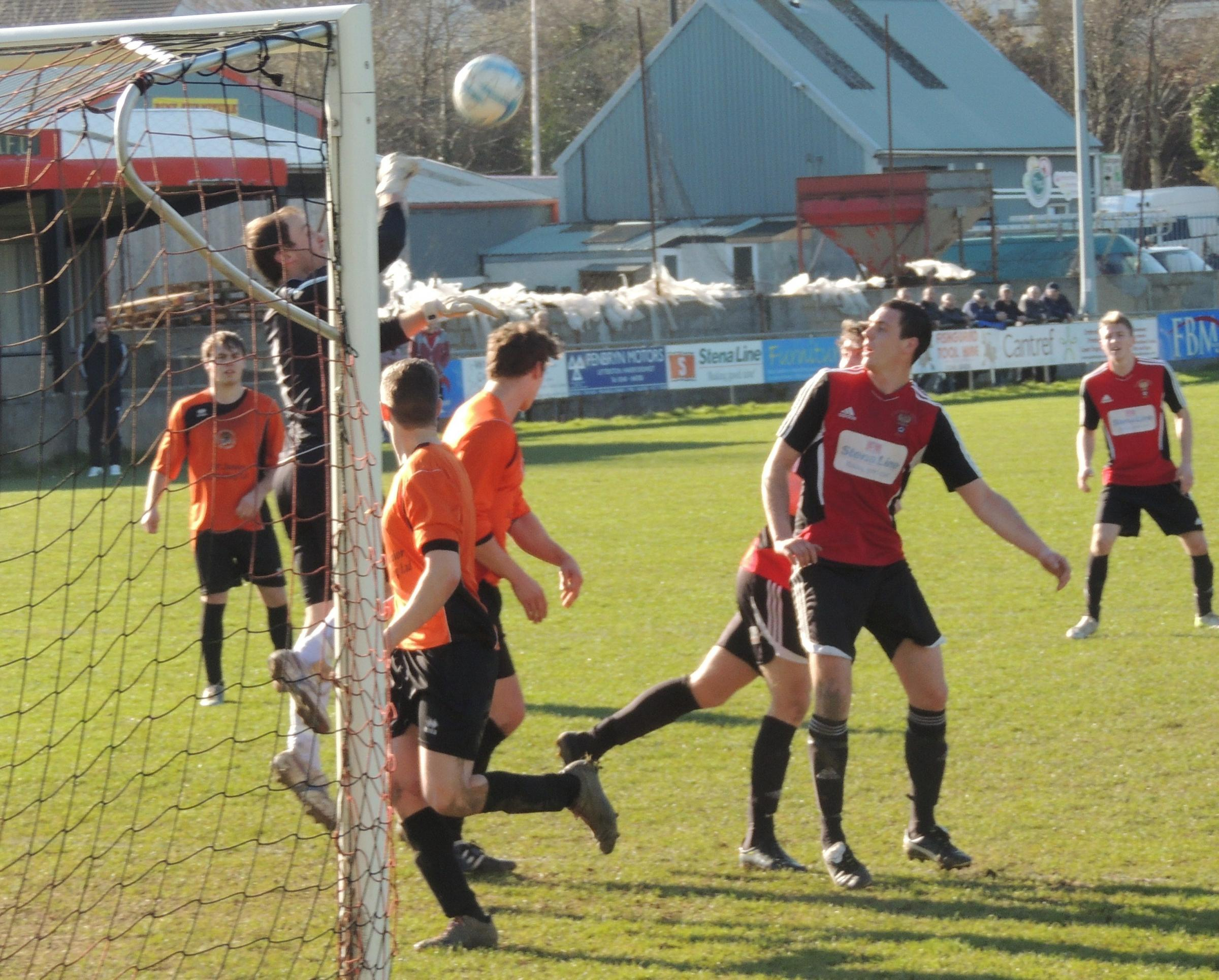 KEEPER'S BALL: Johnston goalkeeper Martin Langdon punches clear.PICTURE: Bill Carne (4649632)