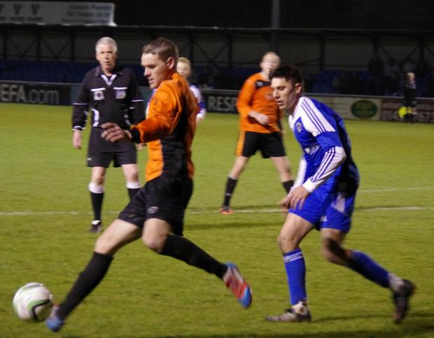 CLOSE ATTENTION: Nicky Woodrow is tracked by Matthew D'Ivry during the Senior Cup semi final between Johnston and Merlins Bridge.