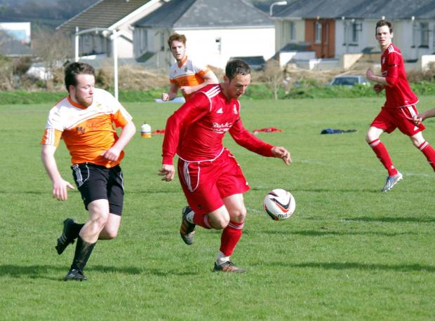 BEST FOOT FORWARD: Jamie Palmer pushes forward for West Dragons in their win against Saundersfoot Sport. PICTURE: Western Telegraph. (4817372)