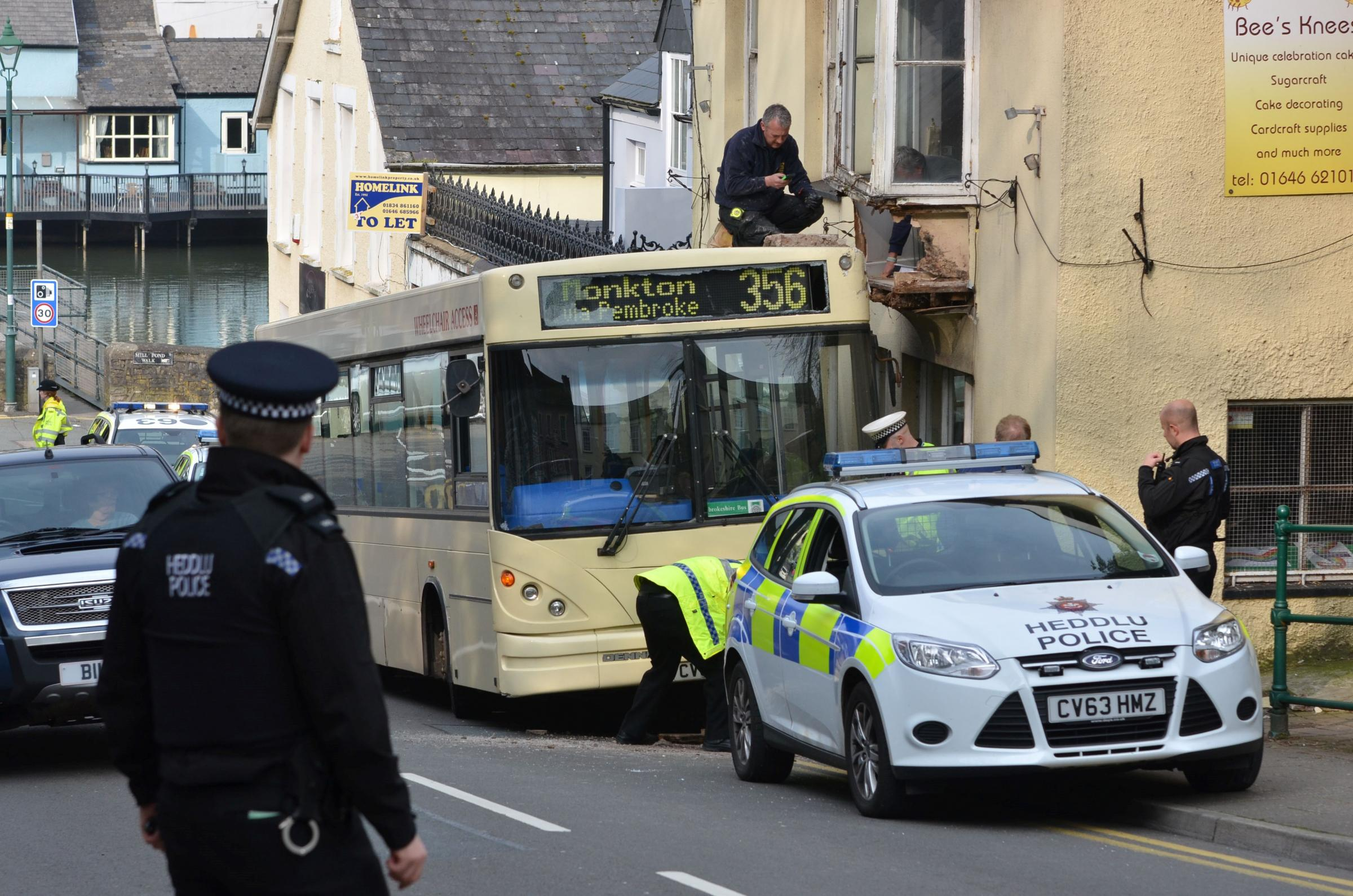 Pembroke traffic problems after bus hits shop window