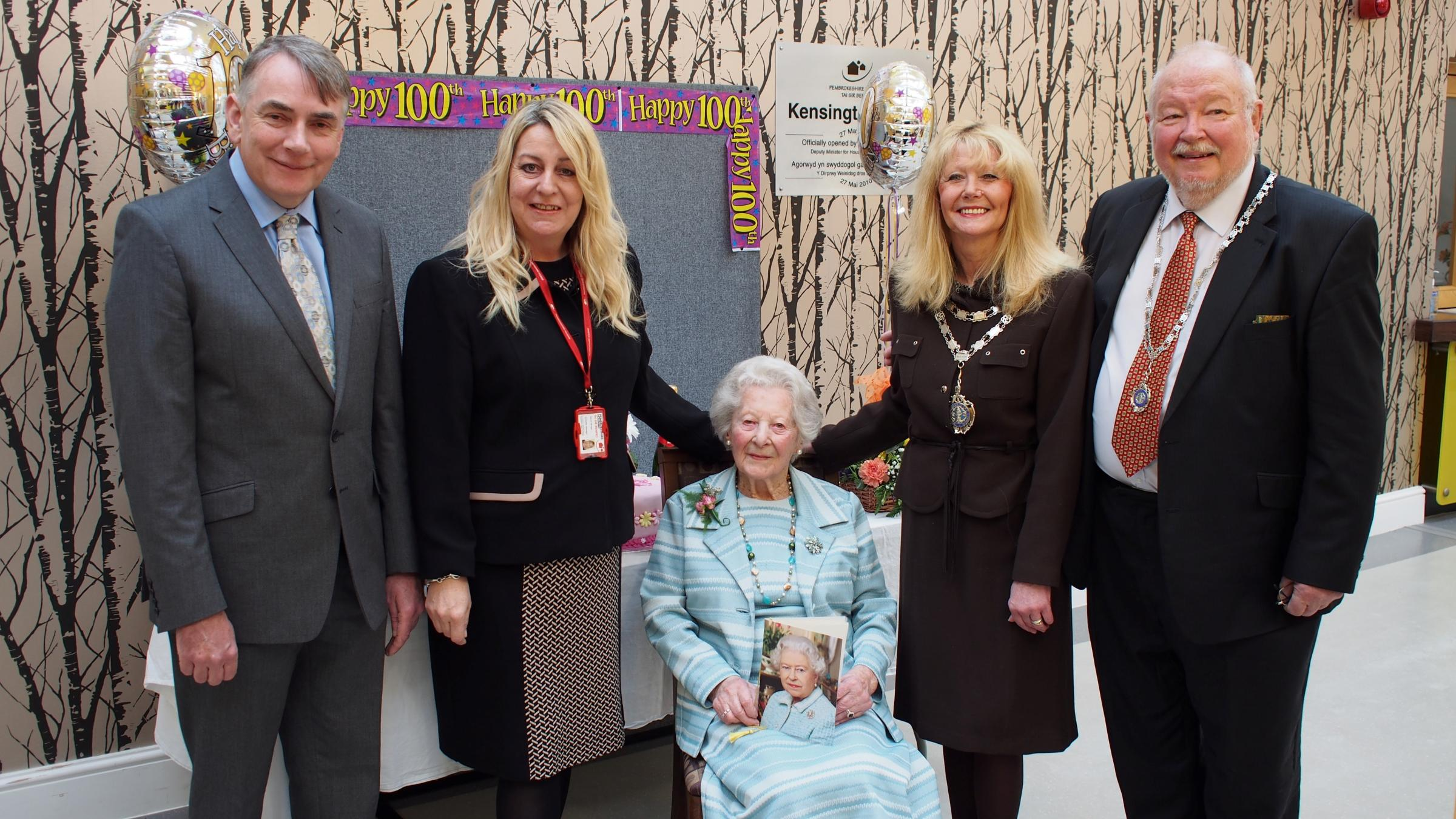 CELEBRATING 100 YEARS: Graham Holmes, Pembrokeshire Housing Karen Brown, Kensington Court scheme manager, Miss Nancy Llewellyn, Mayor Cllr Yvonne Southwell, and Mayor's consort Ron Southwell. PICTURE: Milford Mercury. (5025787)