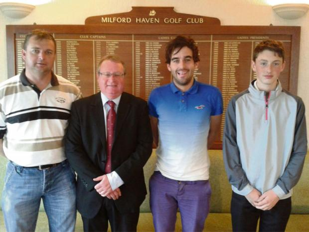Milford Mercury: MONTHLY MEDAL: Karl Rhead, Sean Conway and Josh Lewis with club captain Gwyn Scales. (5237716)