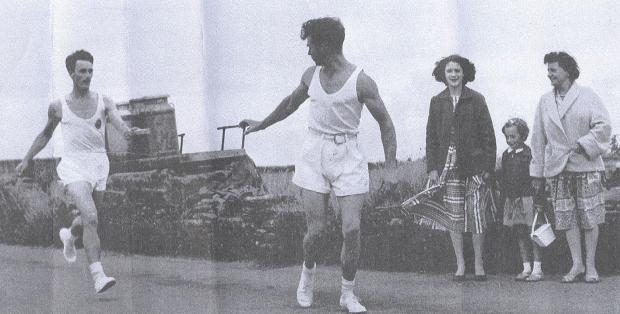 ON THE RUN: Barry Webb receiving the Queen's Baton relay in the Eglwyswrw area back in 1958. (5333464)