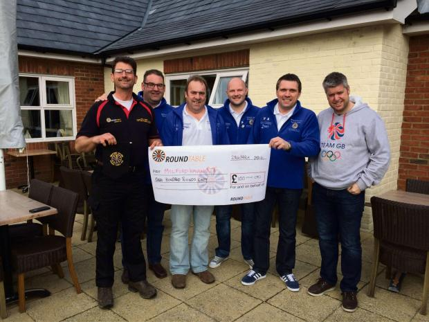 CAH INJECTION: Members of Milford Haven Round Table receiving a donation from Deeside Round Table, (5509407)