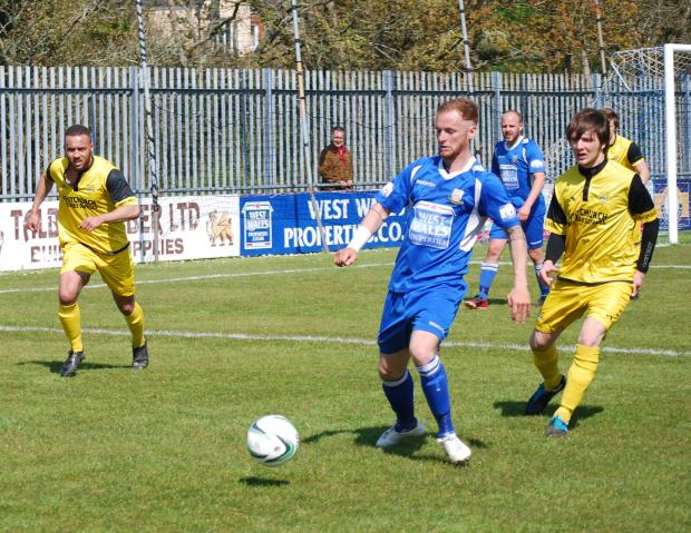 Haverfordwest County's Chris O'Sullivan in possession against Taffs Well at the Conygar Bridge Meadow on Easter Monday. PICTURE: Kevin Bryce
