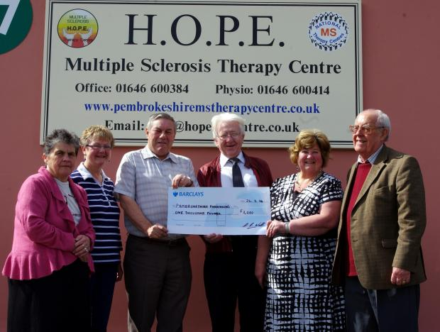 CHEQUE IT OUT: Jane Don, Andrea Gainfort, chairman Norman Gray, Barry Webb, secretary Gaynor Robinson and treasurer Islwyn Bevan. PICTURE: Milford Mercury
