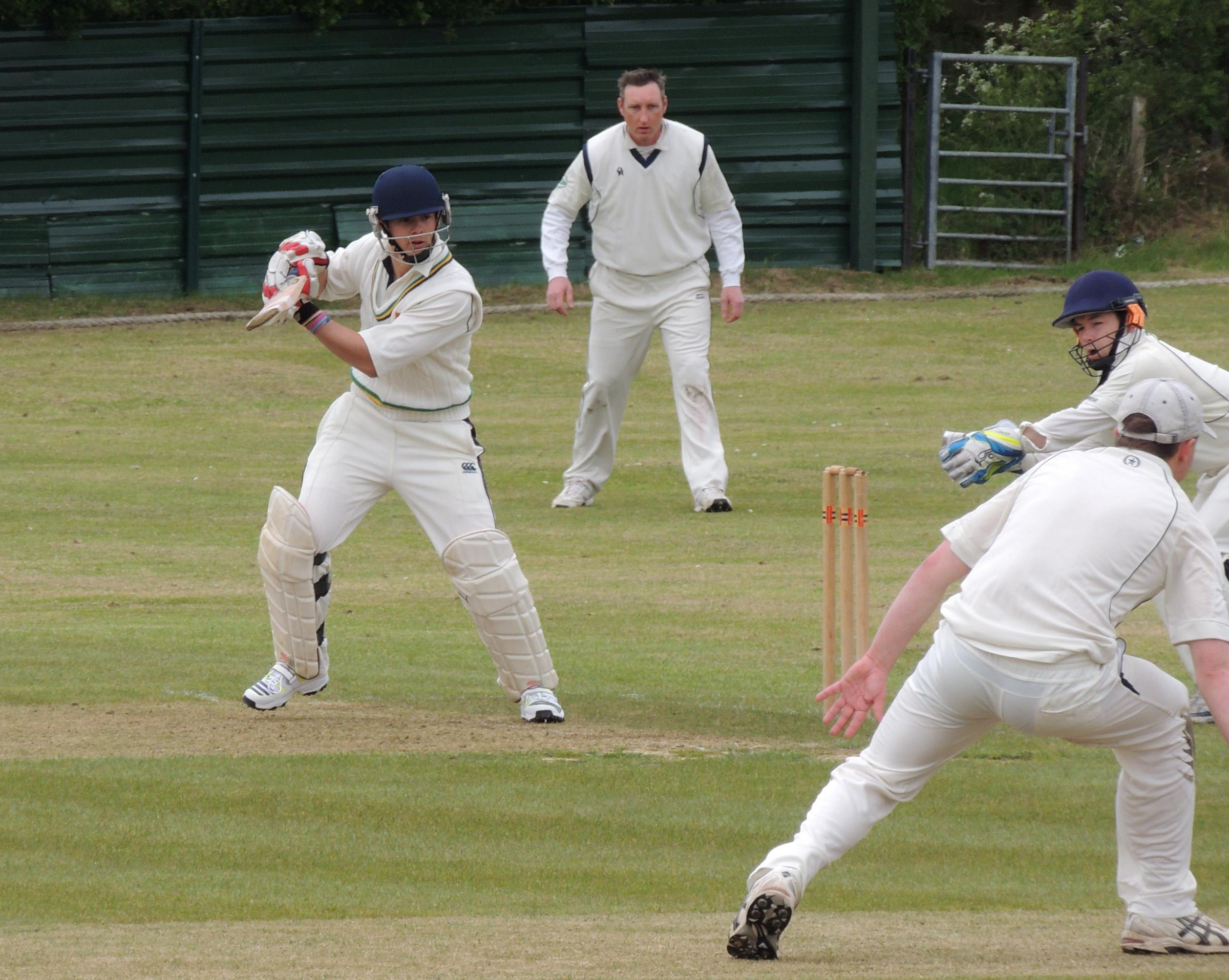 SQUARE CUT: Joe Kiff cuts a ball for four in a winning debut as captain of Llangwm. PICTURE: Bill Carne. (5929676)