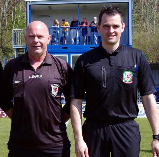 Milford Mercury: MEN IN BLACK: Pembrokeshire officials Dean Boswell and Kevin Bowen relishing being part of the West Wales Intermediate Cup. (5947400)