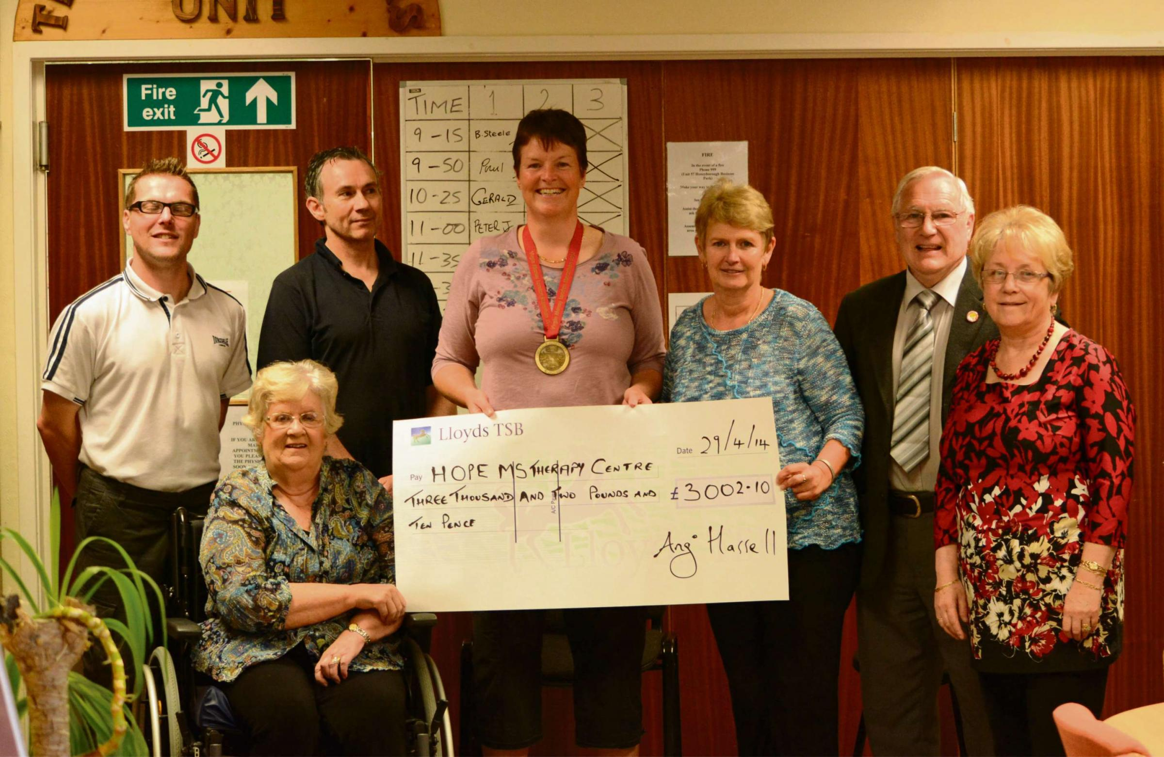 MARATHON EFFORT: Angi and Haulwen present a cheque for more than £3,000 to HOPE chairman Ken Brombley and Margaret Brace, HOPE sec