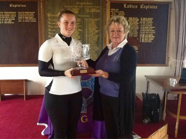 COUNTY CHAMP: Delighted Georgia Thomas (left) receives the coveted ladies' trophy. (6044903)
